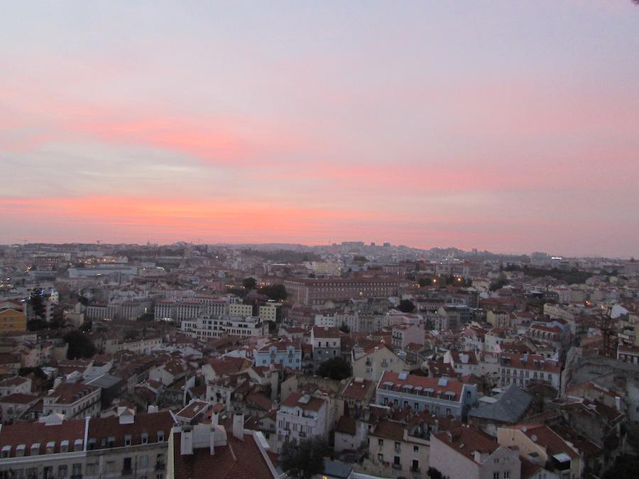 Discovering Lisbon at night at the Miradouro de Graca at sunset