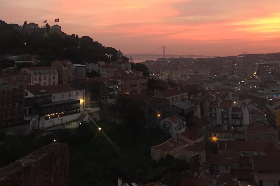 Discovering Lisbon at night at the Miradouro de Graca at dusk