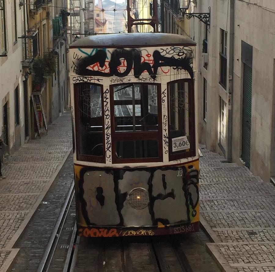 Rua da Bica de Duarte Belo really comes alive in Lisbon at night